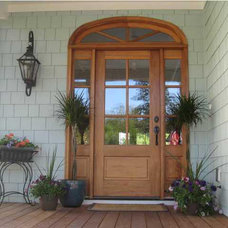 Traditional Entry by Coastal Home Plans
