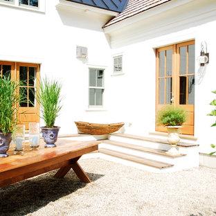 Неиссякаемый источник вдохновения для домашнего уюта: прихожая в классическом стиле с двустворчатой входной дверью и стеклянной входной дверью