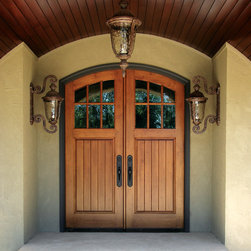 Main Entry - Arched top double door with 6 light (true divided light) glass & V-groove panels.