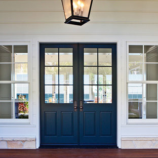Inspiration for a mid-sized timeless dark wood floor entryway remodel in Los Angeles with white walls and a blue front door
