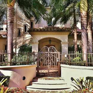 Photo of a mediterranean entrance in Miami with a metal front door.