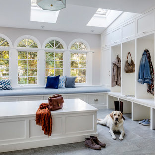 Example of a large transitional ceramic tile and gray floor mudroom design in Boston with gray walls