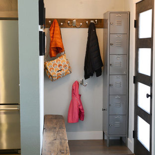 Entryway - small transitional dark wood floor entryway idea in Denver with white walls and a glass front door