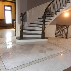 Traditional Entry by Designing Interiors Inc