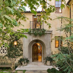 Inspiration for a mediterranean single front door remodel in Los Angeles with a medium wood front door