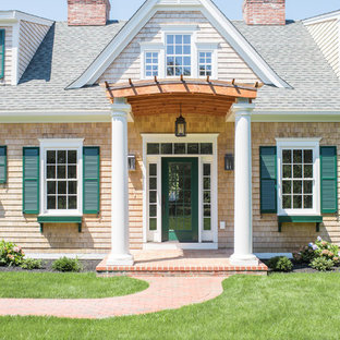 Entryway - large coastal entryway idea in Providence with a green front door