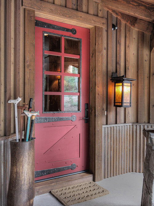 Elegant single front door photo in Phoenix with a red front door & Rustic Cabin Doors | Houzz