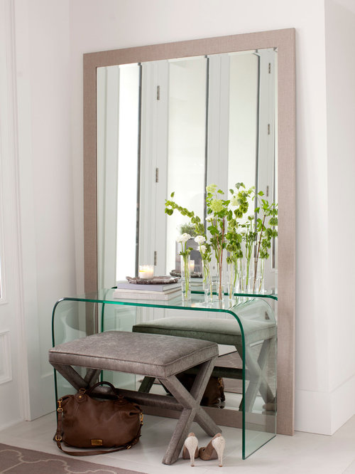 Trendy White Floor Entryway Photo In Vancouver With White Walls