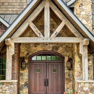 Entryway - rustic entryway idea in Charlotte with a dark wood front door