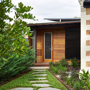 Photo of a contemporary front door in Adelaide with brown walls, a single front door and a glass front door.