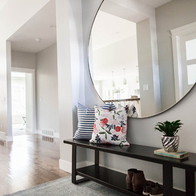 Example of a mid-sized transitional medium tone wood floor entryway design in Salt Lake City with gray walls and a medium wood front door