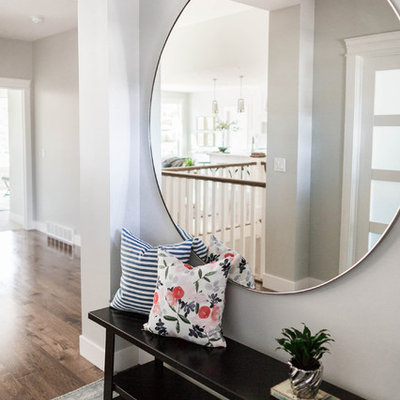 Inspiration for a mid-sized transitional medium tone wood floor entryway remodel in Salt Lake City with gray walls and a medium wood front door
