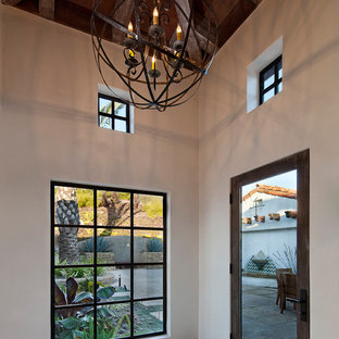 Tuscan entryway photo in Santa Barbara with a glass front door