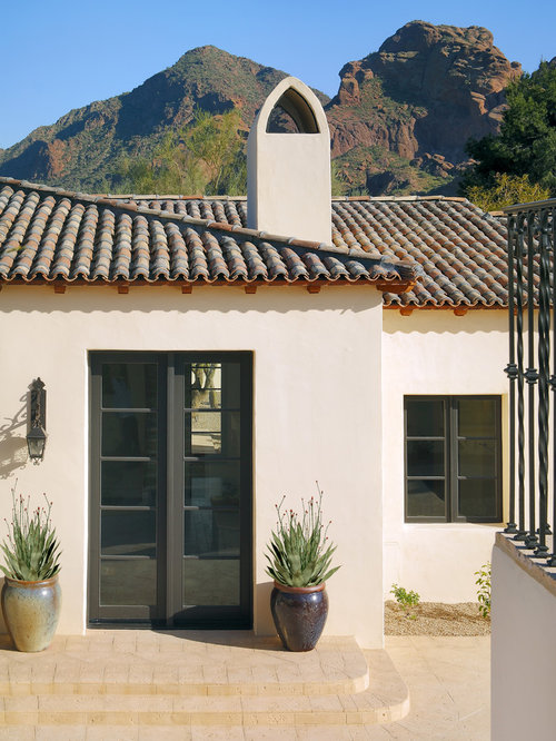 Stucco Design Ideas custom enclosure with stone skirting Tuscan Entryway Photo In Phoenix