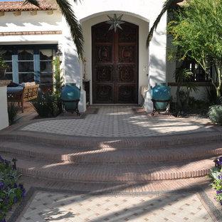 Tuscan double front door photo in Phoenix with a dark wood front door