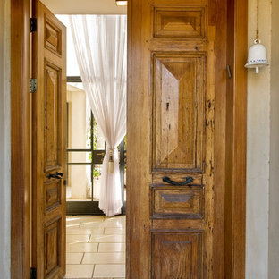 This is an example of a country front door in Tel Aviv with a double front door and a medium wood front door.