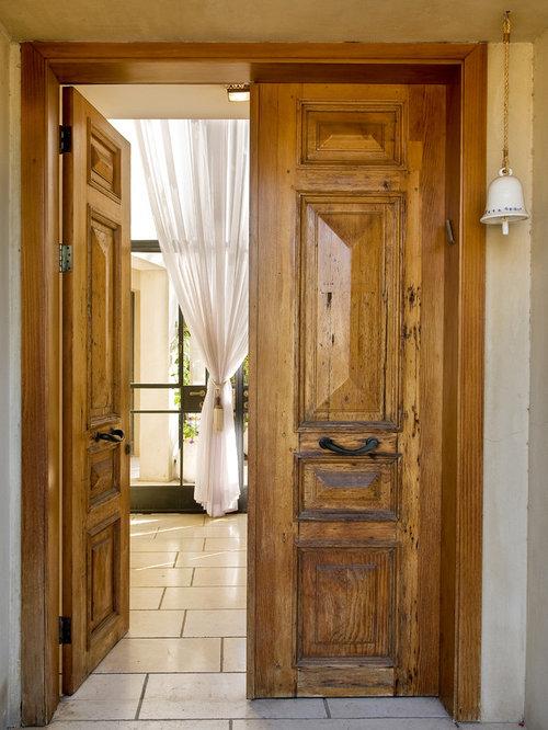 Rustic Entryway Idea In Tel Aviv With A Medium Wood Front Door