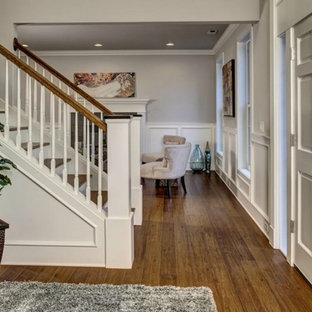 Inspiration for a mid-sized timeless bamboo floor and brown floor entryway remodel in Seattle with beige walls and a white front door