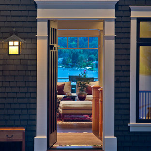 Mid-sized elegant dark wood floor entryway photo in Seattle with blue walls and a black front door