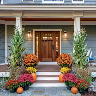 Entryway - mid-sized craftsman brown floor entryway idea in Boston with blue walls and a medium wood front door