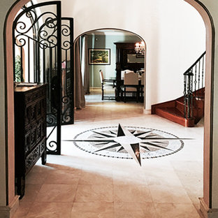 Inspiration for a large mediterranean beige floor entryway remodel in Miami with beige walls and a metal front door