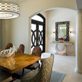 Idéer för en mellanstor medelhavsstil entré, med beige väggar, en dubbeldörr, travertin golv, mörk trädörr och beiget golv