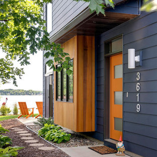 Single front door - contemporary single front door idea in Minneapolis with an orange front door