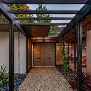 Entryway - mid-sized 1950s entryway idea in Los Angeles with a brown front door