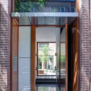 Urban entryway photo in Chicago with a medium wood front door