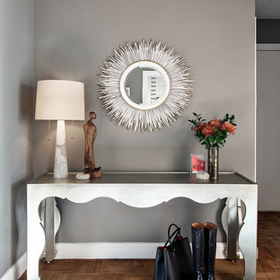 Example of a transitional entry hall design in Seattle with gray walls