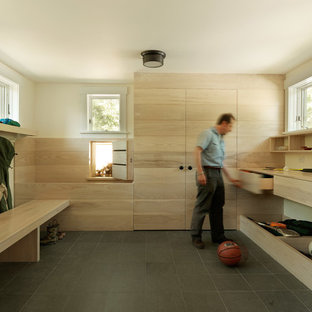 Inspiration for a rustic mudroom remodel in Burlington with white walls