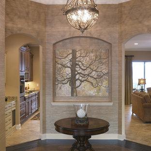 Entryway - traditional dark wood floor entryway idea in Jacksonville with beige walls