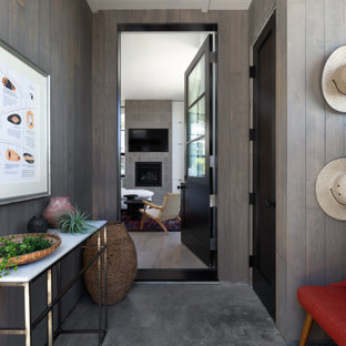 Example of a mid-sized trendy gray floor entryway design in San Francisco with gray walls and a black front door