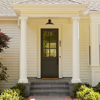 Example of a classic entryway design in San Francisco with a glass front door