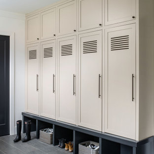 Inspiration for a contemporary gray floor mudroom remodel in DC Metro with white walls and a black front door