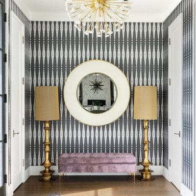 Foyer - contemporary medium tone wood floor foyer idea in Chicago with multicolored walls