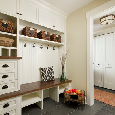 Example of a mid-sized classic slate floor mudroom design in Minneapolis with beige walls