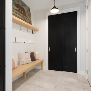 Inspiration for a farmhouse gray floor mudroom remodel in Minneapolis with gray walls