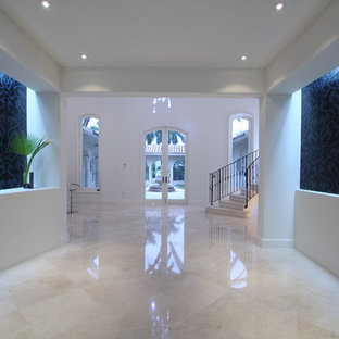 Large trendy marble floor and white floor foyer photo in Miami