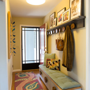 Photo Of A Small Modern Entry Hall In San Francisco With Beige Walls,  Medium Hardwood