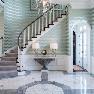This is an example of a traditional foyer in Louisville with green walls and multi-coloured floor.
