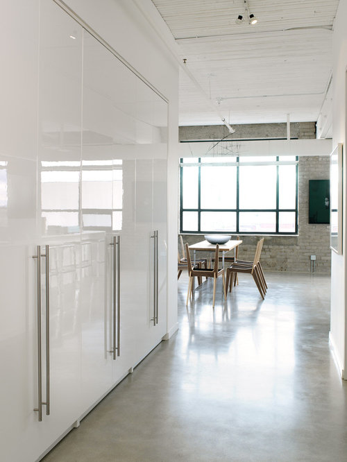 Industrial Concrete Floor Entry Hall Idea In Toronto With White Walls
