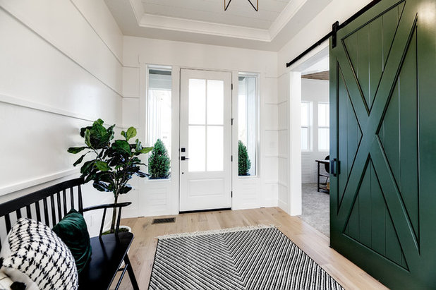 Farmhouse Entry by Solitude Homes
