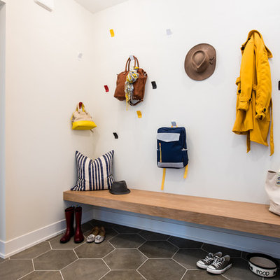 Inspiration for a transitional ceramic tile and gray floor mudroom remodel in Minneapolis with white walls