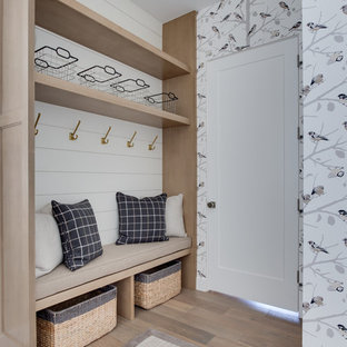 Design ideas for a country mudroom in Salt Lake City with multi-coloured walls, light hardwood floors, a single front door, a white front door and beige floor.