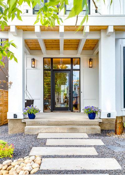 Farmhouse Entry by Trickle Creek Designer Homes