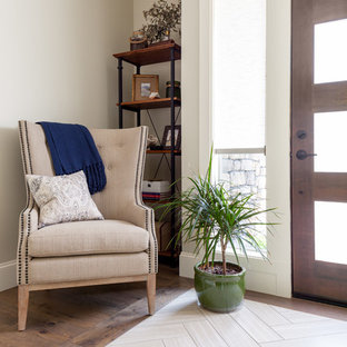 Entryway - mid-sized country medium tone wood floor and brown floor entryway idea in Seattle with gray walls and a dark wood front door