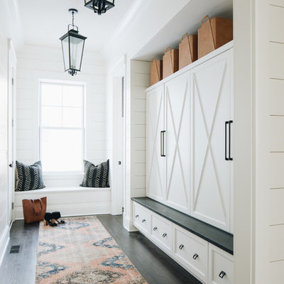 Farmhouse dark wood floor and brown floor mudroom photo in Chicago with white walls