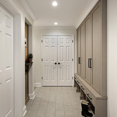 Inspiration for a large transitional porcelain tile and beige floor mudroom remodel in Chicago with white walls