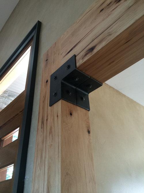entr e industrielle avec une porte pivot photos et id es d co d 39 entr es de maison ou d 39 appartement. Black Bedroom Furniture Sets. Home Design Ideas